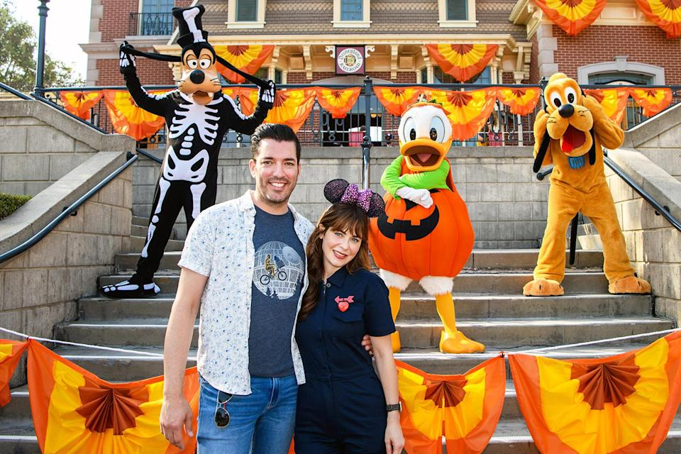 <p>Jonathan Scott and Zooey Deschanel pose for a photo with Goofy, Donald Duck and Pluto while enjoying the Halloween Time festivities at Disneyland Park in Anaheim, Calif., on Sept. 25. </p>