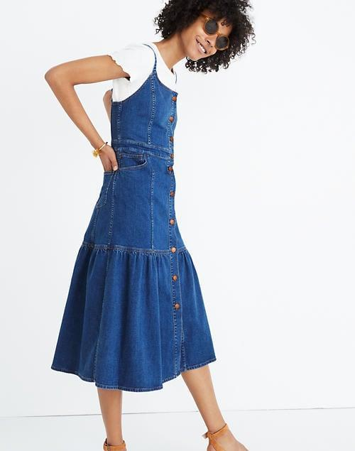 "<p>The silhouette of this <a href=""https://www.popsugar.com/buy/Madewell-Denim-Bayview-Tiered-Midi-Dress-582011?p_name=Madewell%20Denim%20Bayview%20Tiered%20Midi%20Dress&retailer=madewell.com&pid=582011&price=60&evar1=fab%3Aus&evar9=35329485&evar98=https%3A%2F%2Fwww.popsugar.com%2Ffashion%2Fphoto-gallery%2F35329485%2Fimage%2F47550217%2FMadewell-Denim-Bayview-Tiered-Midi-Dress&list1=shopping%2Cdenim%2Csummer%20fashion%2Cfashion%20shopping&prop13=mobile&pdata=1"" class=""link rapid-noclick-resp"" rel=""nofollow noopener"" target=""_blank"" data-ylk=""slk:Madewell Denim Bayview Tiered Midi Dress"">Madewell Denim Bayview Tiered Midi Dress</a> ($60) is so fun.</p>"