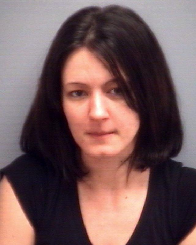 A photo provided by the Virginia Beach police department shows Patience Perez.   According to court records Perez, a former security assistant at a Virginia Beach school conspired to kill her husband while she was having an inappropriate relationship with a 15-year-old student.   (AP Photo/Virginia Beach POlice Department)