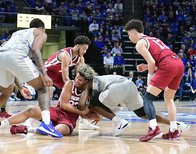 Players fight for a loose ball during an Atlantic 10 Conference basketball game between the University of Massachusetts Minutemen and the Saint Louis Billikens (Photo by Keith Gillett/Icon Sportswire via Getty Images)