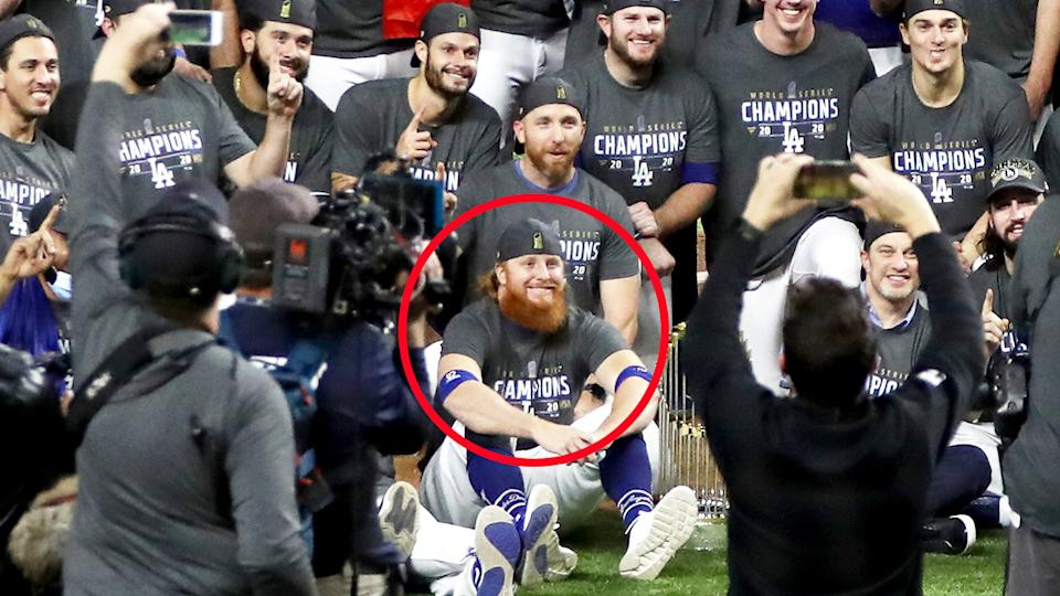 Justin Turner, pictured here posing for photos without a mask on.