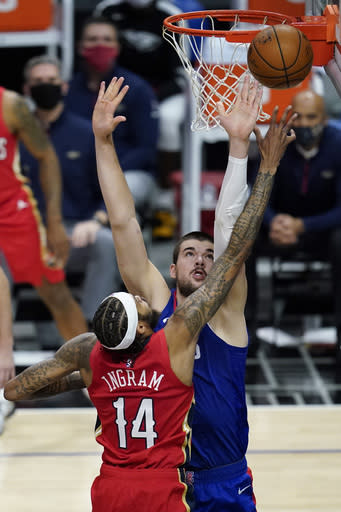 Los Angeles Clippers center Ivica Zubac, rear, defends against New Orleans Pelicans forward Brandon Ingram (14) during the second quarter of an NBA basketball game Wednesday, Jan. 13, 2021, in Los Angeles. (AP Photo/Ashley Landis)