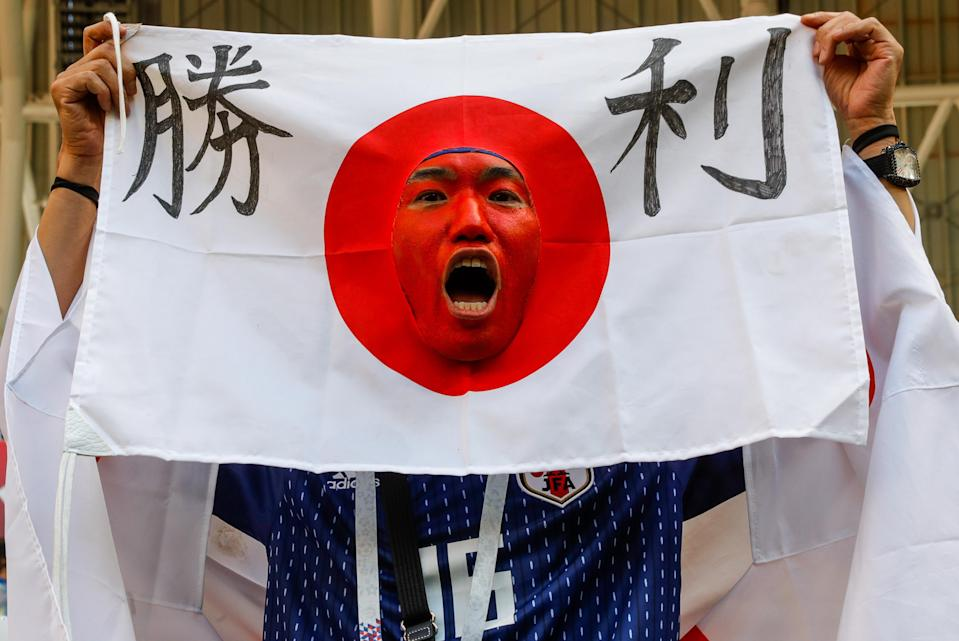 <p>A Japanese football fan celebrates his team winning a 2018 FIFA World Cup Group H Round 1 match against Colombia with a 2-1 score at Mordovia Arena Stadium in Saransk. Mikhail Japaridze/TASS (Photo by Mikhail Japaridze\TASS via Getty Images) </p>