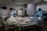 "A COVID-19 patient is transferred to the ""red zone,"" an area reserved for treating those suffering from COVID-19, in the Severo Ochoa Hospital in Leganes on the outskirts of Madrid, Spain, Wednesday, Feb. 17, 2021. (AP Photo/Bernat Armangue)"