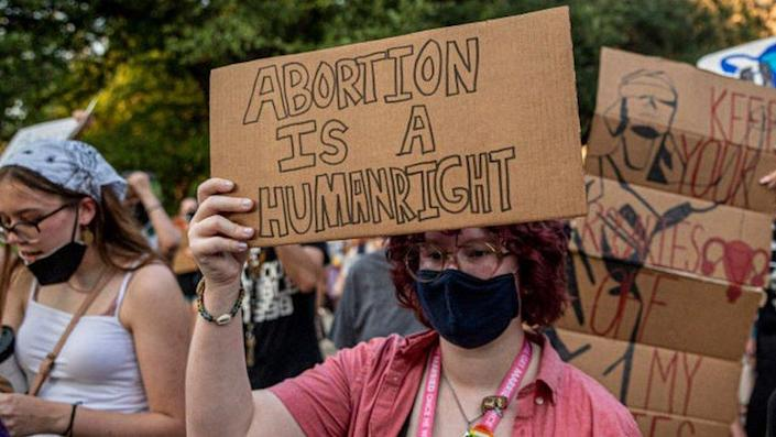 Pro-choice protesters march outside the Texas State Capitol on Wednesday on 1 September