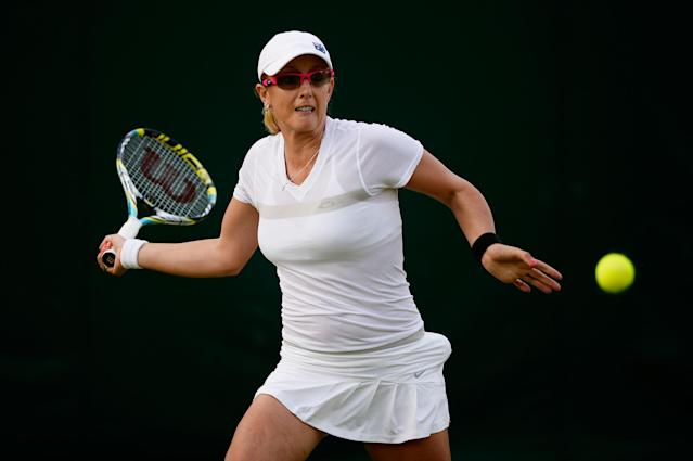 LONDON, ENGLAND - JUNE 26: Anastasia Rodionova of Australia plays a forehand during the Ladies' Doubles first round match between Alla Kudryavtseva of Russia and Anastasia Rodionova of Australia and Andrea Hlavackova of Czech Republic and Lucie Hradecka of Czech Republic on day three of the Wimbledon Lawn Tennis Championships at the All England Lawn Tennis and Croquet Club on June 26, 2013 in London, England. (Photo by Dennis Grombkowski/Getty Images)