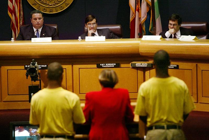 Two cellmates of Omar Paisley, a teen who died in a juvenile detention facility from a ruptured appendix, spoke in September 2003 before a House committee on juvenile justice that met in the Miami-Dade Commission chambers. On the dais were, from left, Chairman Rep. Gus Barreiro, staff member David De La Paz and Rep. Gus Bilirakis. Barreiro, a champion of vulnerable children, died of a heart attack Friday morning, August 16, 2019.