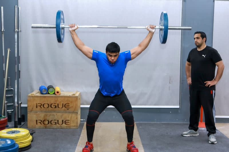 Gaza weight-lifter Mohammad Hamada who is the first Palestinian to compete in the game at the Olympics when it kicks off in Tokyo, practices at a gym in Doha
