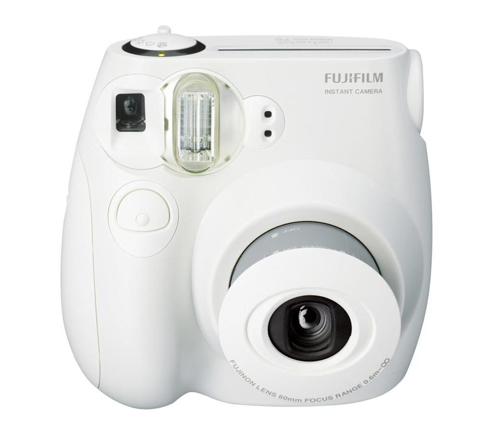 "<p>Remember life before Instagram? This camera will get you in the mood to take real photos again. <a href=""http://www.bhphotovideo.com/c/product/909237-REG/fujifilm_16273398_instax_mini_8_camera.html"" rel=""nofollow noopener"" target=""_blank"" data-ylk=""slk:Fujifilm instax mini 8 Instant Film Camera in White"" class=""link rapid-noclick-resp"">Fujifilm instax mini 8 Instant Film Camera in White</a> ($60)<br></p>"