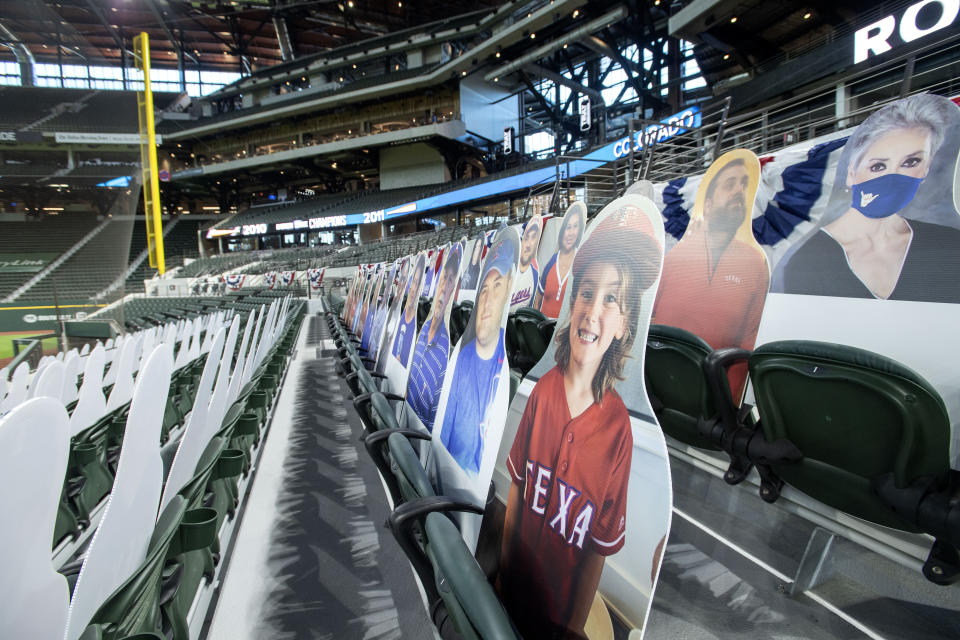 "Cardboard cutouts of Texas Rangers fans, dubbed ""DoppleRangers"" by the club, are positioned in seats before an opening day baseball game against the Colorado Rockies, Friday, July 24, 2020, in Arlington, Texas. (AP Photo/Jeffrey McWhorter)"