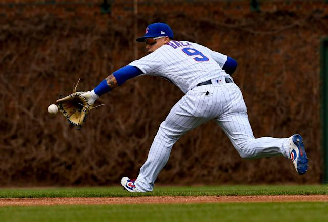 Chicago Cubs shortstop Javier Baez stops a ball hit by Los Angeles Angels' David Fletcher during the first inning of a baseball game Friday, April 12, 2019, in Chicago. (AP Photo)