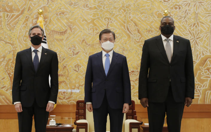 South Korean President Moon Jae-in, center, stands with U.S. Secretary of State Antony Blinken, left, and U.S. Defense Secretary Lloyd Austin as they pose for a photograph before their meeting at the presidential Blue House in Seoul, South Korea, Thursday, March 18, 2021. (AP Photo/Lee Jin-man, Pool)