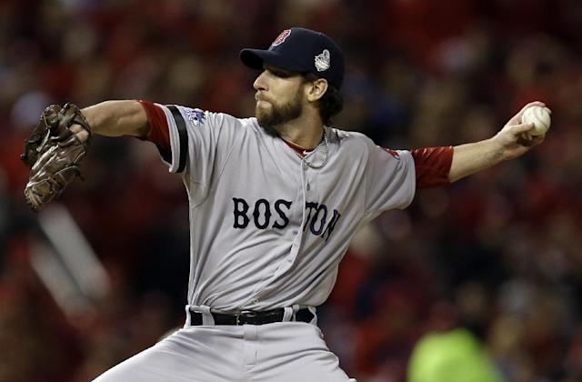 Boston Red Sox relief pitcher Craig Breslow throws during the seventh inning of Game 3 of baseball's World Series against the St. Louis Cardinals Saturday, Oct. 26, 2013, in St. Louis. (AP Photo/Jeff Roberson)