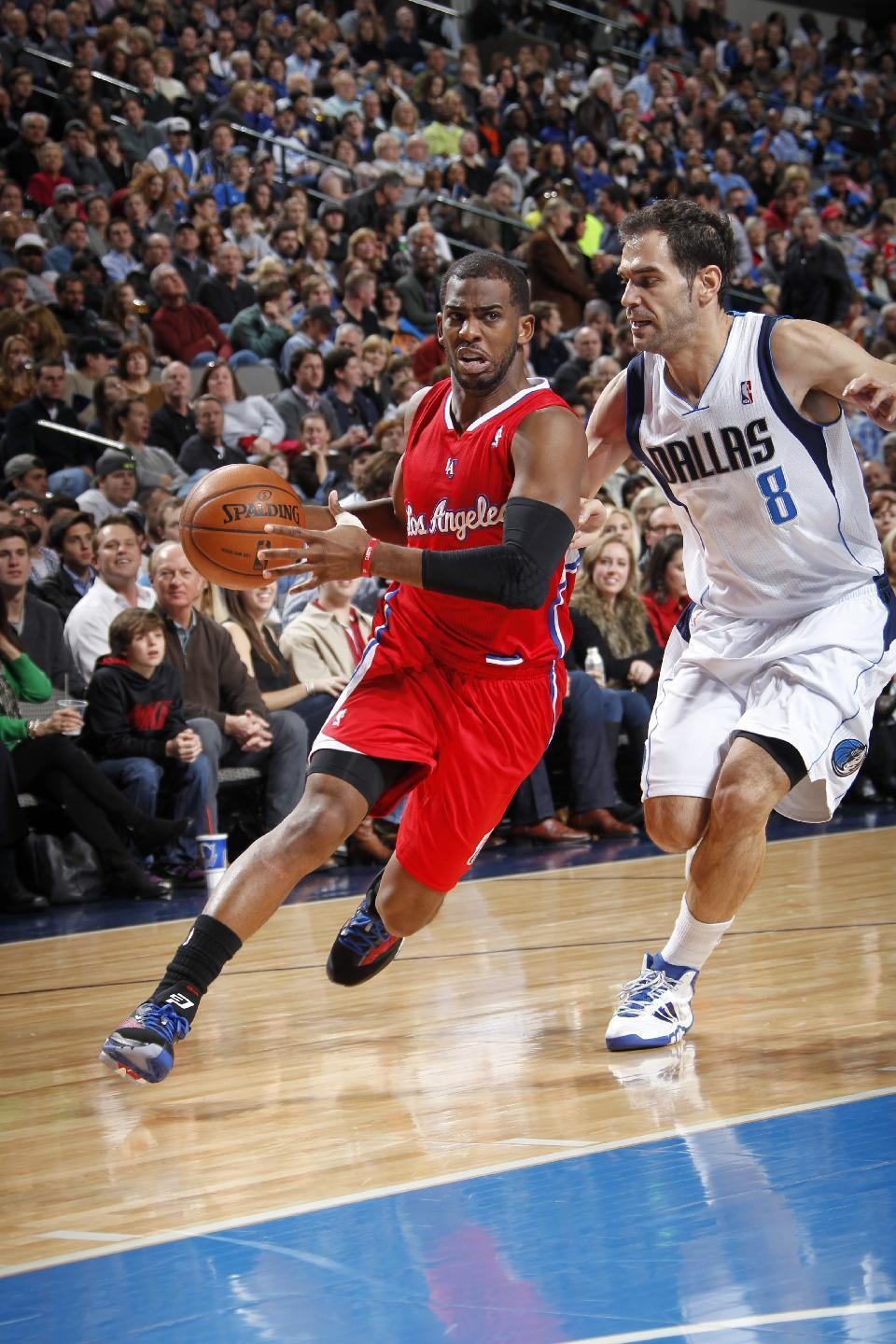 DALLAS, TX - JANUARY 3: Chris Paul #3 of the Los Angeles Clippers drives against Jose Calderon #8 of the Dallas Mavericks on January 3, 2014 at the American Airlines Center in Dallas, Texas. (Photo by Glenn James/NBAE via Getty Images)