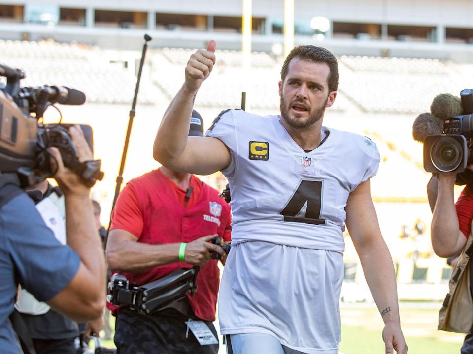 Derek Carr reacts to fans after a win against the Steelers.