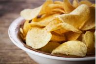 """<p>Increased servings of potato chips tacked on more pounds than any other foods (including sugary drinks, processed meats and red meat) in <u><a href=""""https://www.nejm.org/doi/full/10.1056/NEJMoa1014296"""" rel=""""nofollow noopener"""" target=""""_blank"""" data-ylk=""""slk:a"""" class=""""link rapid-noclick-resp"""">a </a><em><a href=""""https://www.nejm.org/doi/full/10.1056/NEJMoa1014296"""" rel=""""nofollow noopener"""" target=""""_blank"""" data-ylk=""""slk:New England Journal of Medicine"""" class=""""link rapid-noclick-resp"""">New England Journal of Medicine</a></em><a href=""""https://www.nejm.org/doi/full/10.1056/NEJMoa1014296"""" rel=""""nofollow noopener"""" target=""""_blank"""" data-ylk=""""slk:study"""" class=""""link rapid-noclick-resp""""> study</a></u>. </p><p>In addition to ample calories—<u><a href=""""https://www.fritolay.com/snacks/product-page/lays/lays-classic-potato-chips"""" rel=""""nofollow noopener"""" target=""""_blank"""" data-ylk=""""slk:160 calories per serving for 15 Lay's"""" class=""""link rapid-noclick-resp"""">160 calories per serving for 15 Lay's</a></u>—chips are low in fiber and protein while offering a good shake of sodium.</p>"""