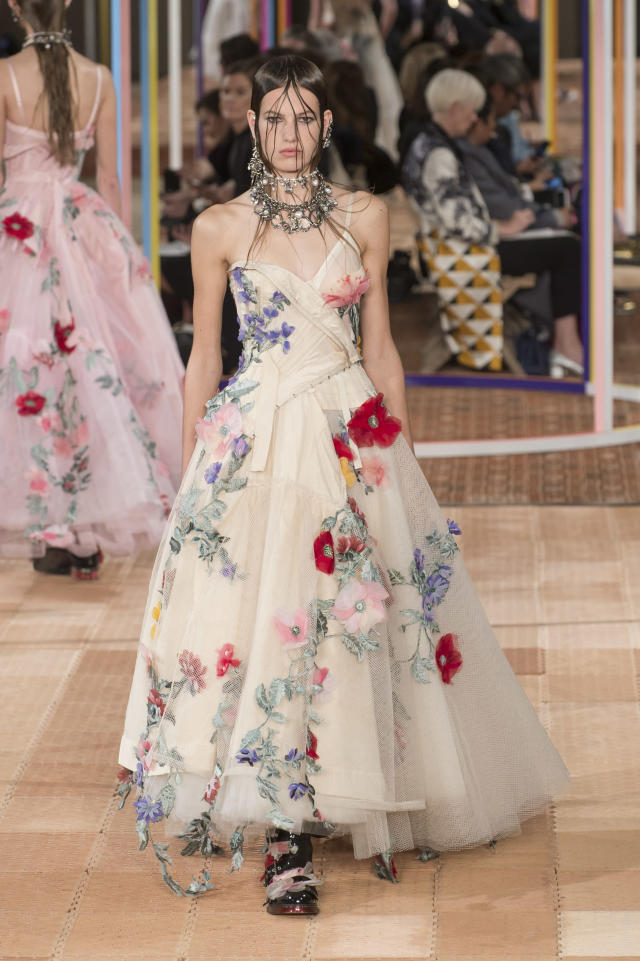 <p><i>Cream tulle gown with floral appliqués from the SS18 Alexander McQueen collection. (Photo: ImaxTree) </i></p>