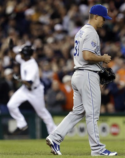 Kansas City Royals starting pitcher Jeremy Guthrie, right, walks back to the mound after giving up a solo home run to Detroit Tigers' Austin Jackson, left, in the fourth inning of a baseball game in Detroit, Wednesday, Sept. 26, 2012. (AP Photo/Paul Sancya)