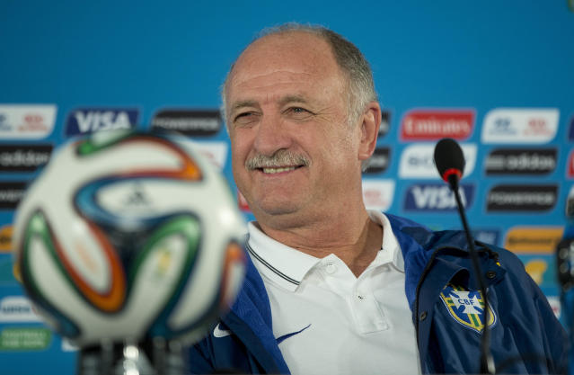 Brazil's coach Luiz Felipe Scolari smiles during a press conference one day before his team's World Cup third-place soccer match against the Netherlands at the Estadio Nacional in Brasilia, Brazil, Friday, July 11, 2014. (AP Photo/Andre Penner)