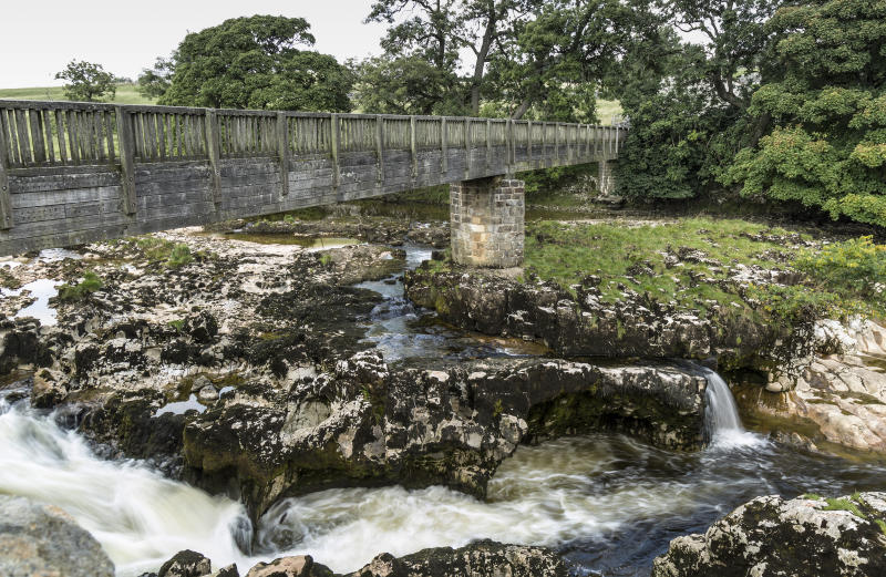 Pedestrian bridge over Linton Falls, near Grassington, Yorkshire
