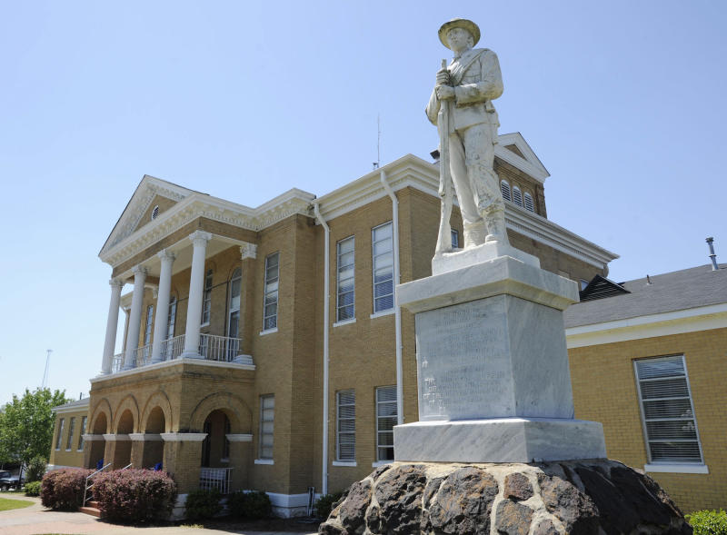 FILE - In this April 10, 2014, file photo,  a Confederate monument stands outside the Choctaw County Courthouse in Butler, Ala. The Alabama Legislature has approved a bill Friday, May 19, 2017, that would prohibit the removal of historic monuments that have stood for more than 40 years. (AP Photo/Jay Reeves, File)