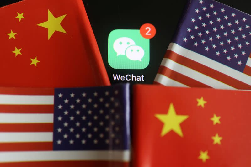 FILE PHOTO: Illustration picture of WeChat app with U.S. and China flags