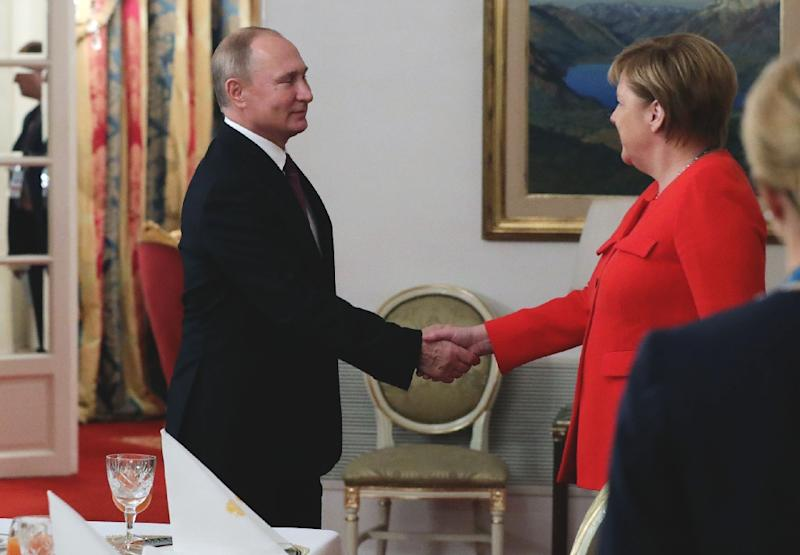 """German Chancellor Angela Merkel voiced her """"concern"""" over the tensions in the Kerch Strait off Russian-annexed Crimea to Vladimir Putin on the sidelines of the G20 summit (AFP Photo/Mikhael Klimentyev)"""