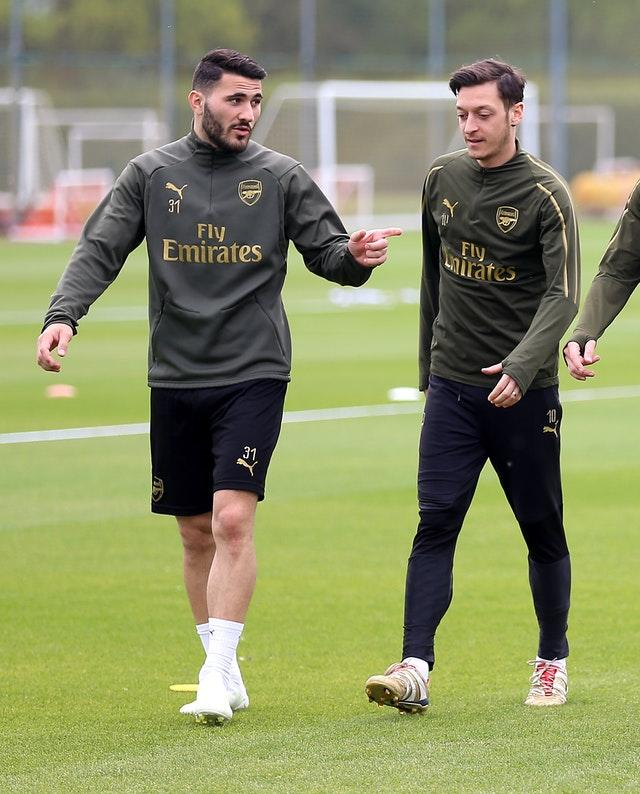 Sead Kolasinac (left) and Mesut Ozil will not be involved at Newcastle (PA)
