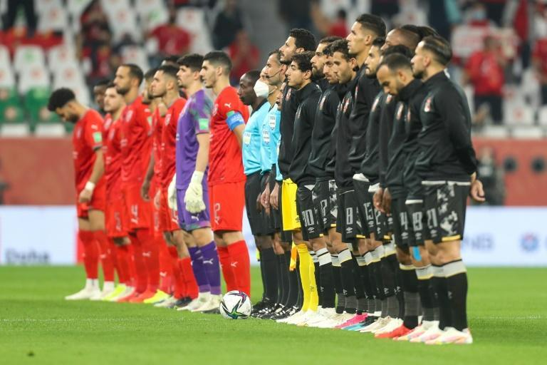 Egypt's Al-Ahly (right) prepare to take on Qatar's Al-Duhail in their first FIFA Club World Cup match in Doha