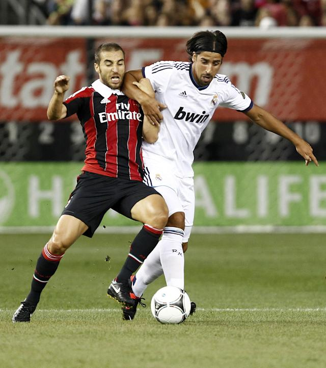 NEW YORK - AUGUST 08: Sami Khedira #6 of Real Madrid and Mathieu Flamini #16 of A.C. Milan fight for the ball during their match at Yankee Stadium on August 8, 2012 in New York City. (Photo by Jeff Zelevansky/Getty Images)