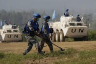 Chinese United Nations troop practice sweeping for mines during the Shared Destiny 2021 drill at the Queshan Peacekeeping Operation training base in Queshan County in central China's Henan province Wednesday, Sept. 15, 2021. Peacekeeping troops from China, Thailand, Mongolia and Pakistan took part in the 10 days long exercise that field reconnaissance, armed escort, response to terrorist attacks, medical evacuation and epidemic control. (AP Photo/Ng Han Guan)