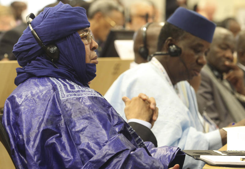 A delegation member of Mali attends the Donor Conference for Development in Mali in Brussels, Wednesday, May 15, 2013. Representatives of 103 countries and organizations are meeting in Brussels to consider the rebuilding of the west African country of Mali as a viable state rather than a safe haven for terrorists.  (AP Photo/Yves Logghe)