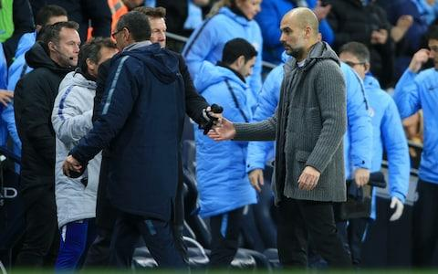 Chelsea manager Maurizio Sarri (L) walks off at the end of the game without shaking hands with Man City manager Pep Guardiola (R) during the Premier League match between Manchester City and Chelsea at the Etihad Stadium on February 10, 2019 in Manchester, United Kingdom - Credit: Getty Images