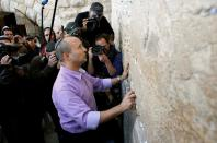 FILE PHOTO: Naftali Bennett, then leader of the Bayit Yehudi party, touches the Western Wall in Jerusalem's Old City