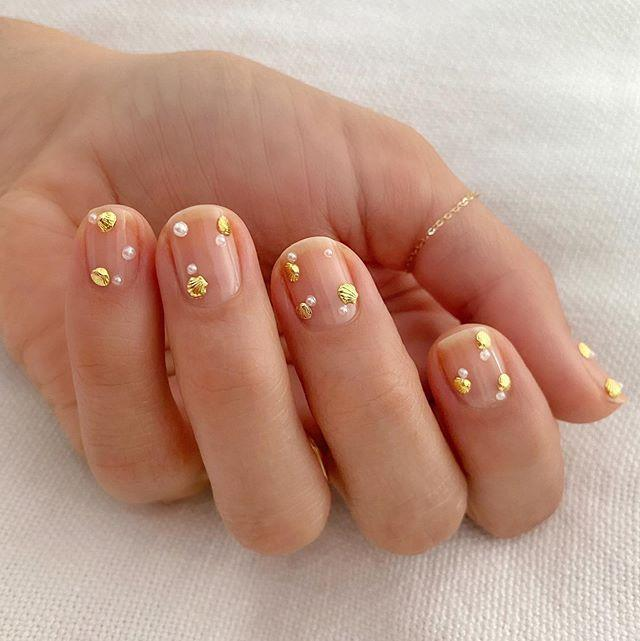 """<p>Getting married by the ocean? Bring the sea life to your nail art with adorable gold shells and delicate pearls.</p><p><a href=""""https://www.instagram.com/p/CCHqHcFjjxg/?utm_source=ig_embed&utm_campaign=loading"""" rel=""""nofollow noopener"""" target=""""_blank"""" data-ylk=""""slk:See the original post on Instagram"""" class=""""link rapid-noclick-resp"""">See the original post on Instagram</a></p>"""