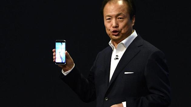 JK Shin, CEO of Samsung's mobile division, shows off a new Galaxy phone (AP)