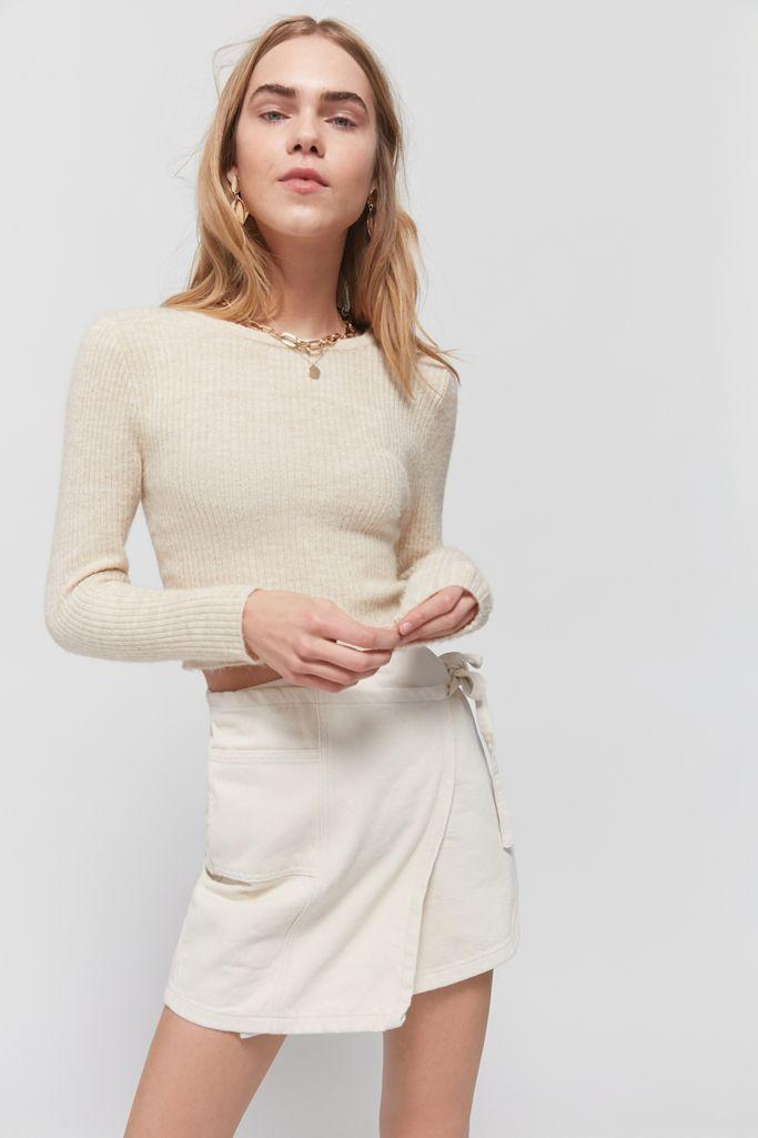 """<p><strong>BDG</strong></p><p>urbanoutfitters.com</p><p><strong>$59.00</strong></p><p><a href=""""https://go.redirectingat.com?id=74968X1596630&url=https%3A%2F%2Fwww.urbanoutfitters.com%2Fshop%2Fbdg-denim-mini-wrap-skirt2&sref=https%3A%2F%2Fwww.goodhousekeeping.com%2Fholidays%2Fg32302046%2Ffourth-of-july-outfit-ideas%2F"""" rel=""""nofollow noopener"""" target=""""_blank"""" data-ylk=""""slk:Shop Now"""" class=""""link rapid-noclick-resp"""">Shop Now</a></p><p>A white denim skirt is a summer staple and an easy piece to mix and match with whatever you have in your closet. To create a chic outfit for 4th of July, wear it with a basic white top or white graphic tee, and a pair of <a href=""""https://go.redirectingat.com?id=74968X1596630&url=https%3A%2F%2Fwww.urbanoutfitters.com%2Fshop%2Fmetal-heart-sunglasses&sref=https%3A%2F%2Fwww.goodhousekeeping.com%2Fholidays%2Fg32302046%2Ffourth-of-july-outfit-ideas%2F"""" rel=""""nofollow noopener"""" target=""""_blank"""" data-ylk=""""slk:red sunglasses"""" class=""""link rapid-noclick-resp"""">red sunglasses</a>. </p>"""