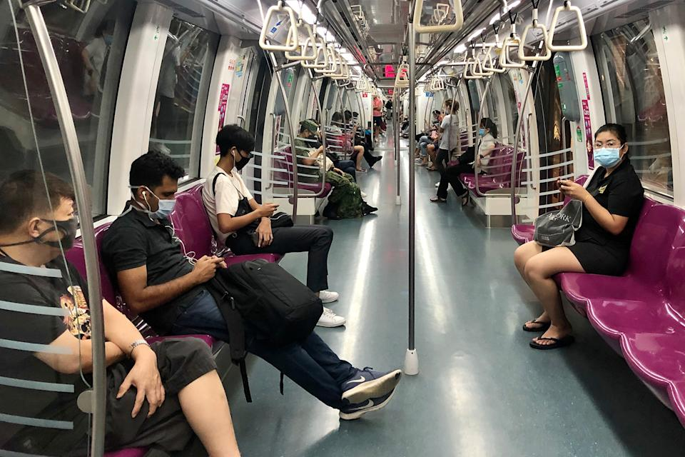 Commuters wearing face masks while travelling aboard a Circle Line train on 7 April 2020, the first day of Singapore's month-long circuit breaker period. (PHOTO: Dhany Osman / Yahoo News Singapore)