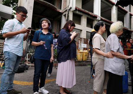 People wait to cast their vote in the general election at a polling station in Bangkok, Thailand, March 24, 2019. REUTERS/Soe Zeya Tun