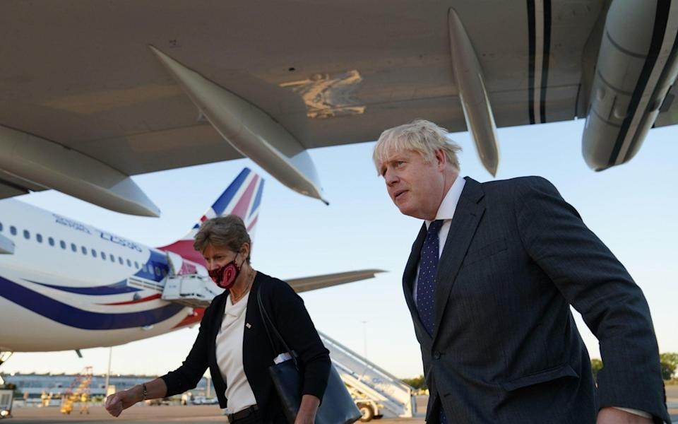 Prime Minister Boris Johnson with Dame Barbara Janet Woodward, the UK's Permanent Representative to the United Nations, after landing in New York - Stefan Rousseau/PA