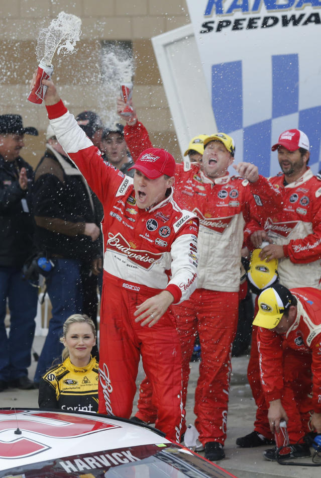 Driver Kevin Harvick celebrates in victory lane after winning a NASCAR Sprint Cup series auto race at Kansas Speedway in Kansas City, Kan., Sunday, Oct. 6, 2013. Harvick won the Hollywood Casino 400. (AP Photo/Orlin Wagner)