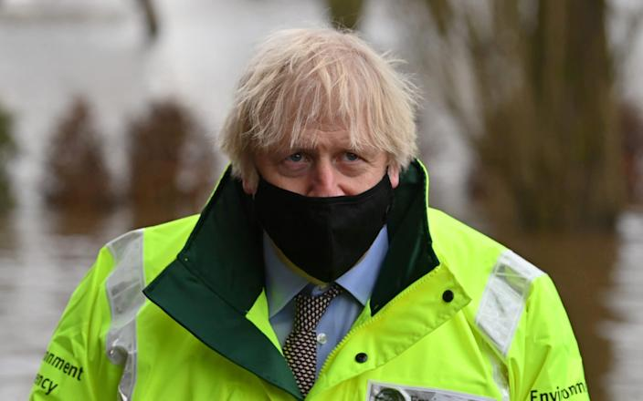 Prime Minister Boris Johnson reacts during his visit to Withington in Manchester - Paul Ellis/Pool via Reuters