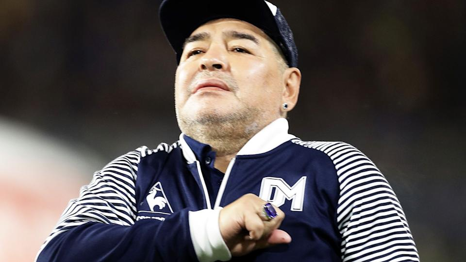 Diego Maradona, pictured here at an Argentina First Division football match in March.