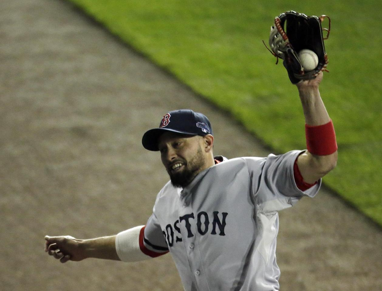 Boston Red Sox right fielder Shane Victorino makes a catch on a Detroit Tigers' Miguel Cabrera fly ball in the seventh inning during Game 4 of the American League baseball championship series Wednesday, Oct. 16, 2013, in Detroit. (AP Photo/Charlie Riedel)