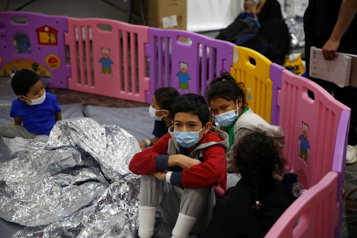 Young unaccompanied migrants, who range in age from 3 to 9, sit inside a playpen at the U.S. Customs and Border Protection facility in Donna, Texas on March 30, 2021. The main detention center for unaccompanied children in the Rio Grande Valley, the Donna facility is holding 4,100 migrants, most of whom are unaccompanied minors, four times its pre-COVID capacity. (Dario Lopez-Mills/Pool via Reuters)