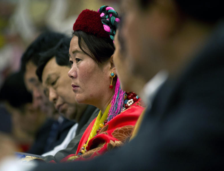 Tibetan delegates attend a Tibetan province delegation meeting held inside the Great Hall of the People as part of the National People's Congress in Beijing, China, Wednesday, March 7, 2012. Chinese officials sought Wednesday to discredit Tibetans who have set themselves on fire to protest China's rule over their region, calling them outcasts, criminals and mentally ill people manipulated by the exiled Dalai Lama. (AP Photo/Andy Wong)
