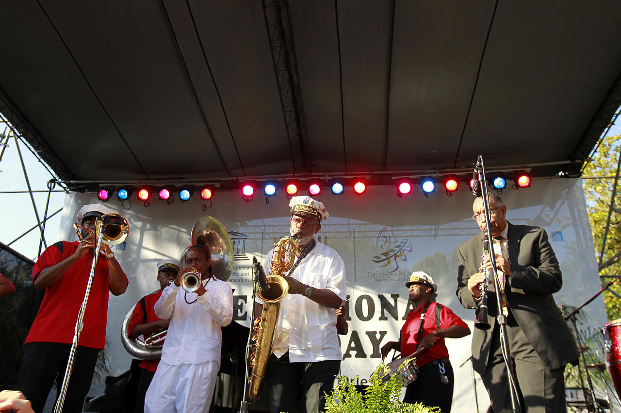 The Treme Brass band performs at a sunrise concert marking International Jazz Day in New Orleans, Monday, April 30, 2012. The performance, at Congo Square near the French Quarter, is one of two in the United States Monday; the other is in the evening in New York. Thousands of people across the globe are expected to participate in International Jazz Day, including events in Belgium, France, Brazil, Algeria and Russia. (AP Photo/Gerald Herbert)
