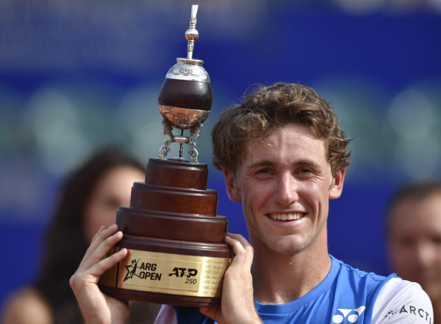 Casper Ruud of Norway poses with the trophy after his 6-1, 6-4, win over Pedro Sousa of Portugal during the ATP Argentina Open final match in Buenos Aires, Argentina, Sunday, Feb. 16, 2020. (AP Photo/Gustavo Garello)