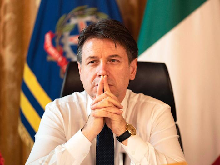 Giuseppe Conte in his office at Chigi Palace, Rome (EPA)