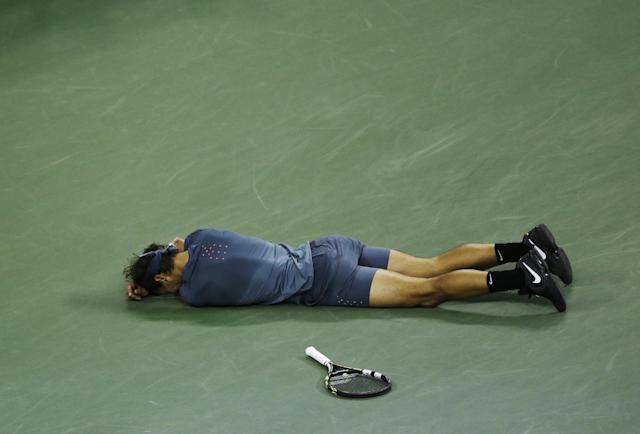 Rafael Nadal, of Spain, lays on the court after defeating Novak Djokovic, of Serbia, in the men's singles final of the 2013 U.S. Open tennis tournament, Monday, Sept. 9, 2013, in New York. (AP Photo/Julio Cortez)